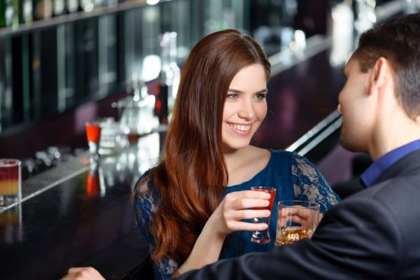 Young Singles At The Bar Flirting And Drinking Age 20 - 39